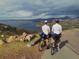 two-young-men-on-bicycles-in-scotland-as-they-raise-money-for-the-david-nott-foundation